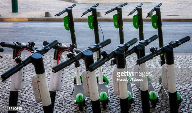 Bird escooters are parked in front LimeS escooters in Cais do Sodre on May 12 2019 in Lisbon Portugal Bird an electric scooter sharing company based...
