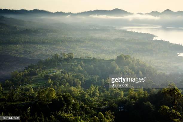 bird eye view of Batur volcano and Stuning view sunrise of batur lake near kintamani mountain  area bali day and night series