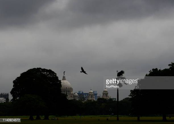 A bird flies as the dense cloud forms over Victoria Memorial Hall in Kolkata on 03 May 2019 as the cyclonic storm Fani hits the coastal places of...