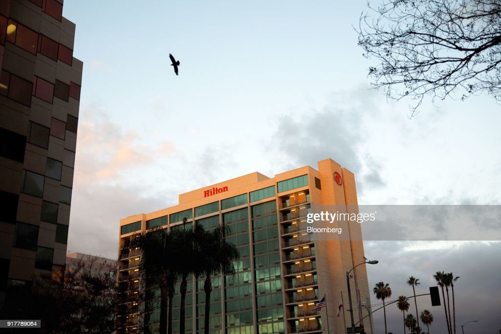 A bird flies near the Hilton Pasadena hotel in Pasadena, California, U.S., on Monday, Feb. 12, 2018. Hilton Worldwide Holdings Inc. is scheduled to release earnings on February 14. Photographer: Patrick T. Fallon/Bloomberg via Getty Images