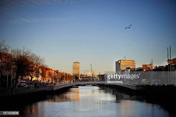 A bird flies over the River Iffey above the Ha'penny Bridge in Dublin Ireland on Saturday Dec 1 2012 Ireland's Finance Minister Michael Noonan will...