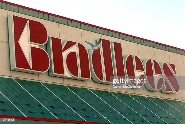 A bird flies past a Bradlees sign December 29 2000 above a store in Somerville MA About 9800 Bradlees employees are poised to lose their jobs once...