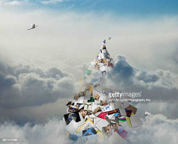 Bird flying in clouds over mountain of information