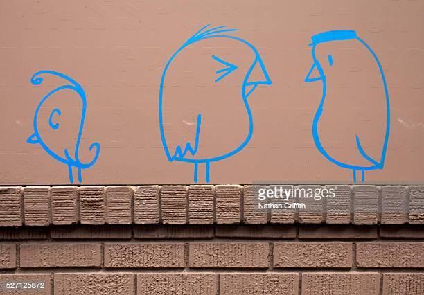 Bird grafitti on building wall