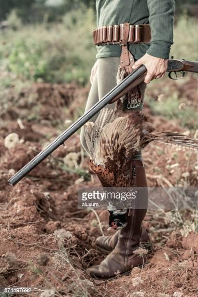 Bird hunter with pheasant