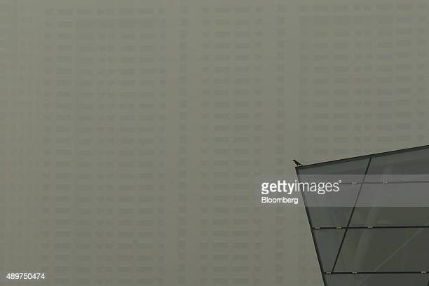 Bird is perched on a building at Marina Bay as buildings in the central business district stand shrouded in smog in Singapore, on Thursday, Sept. 24,...