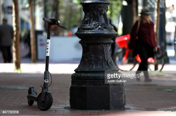 Bird scooter sits parked on a street corner on April 17 2018 in San Francisco California Three weeks after three companies started placing electric...