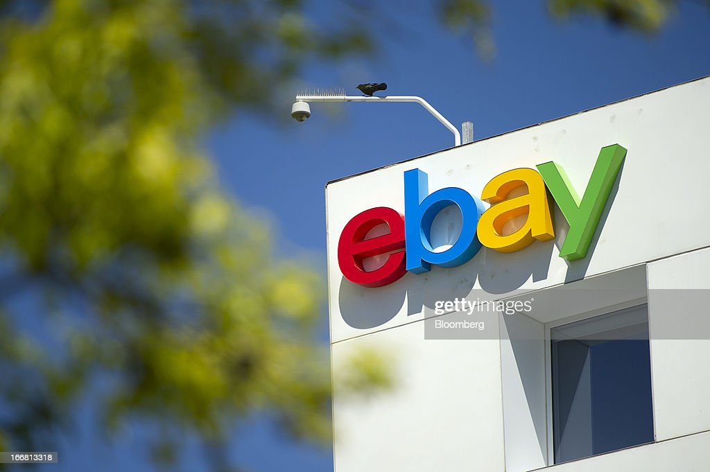 A bird sits over eBay Inc. signage displayed on the facade of the company's headquarters in San Jose, California, U.S., on Tuesday, April 16, 2013. Ebay Inc. is expected to release earnings data on April 17. Photographer: David Paul Morris/Bloomberg via Getty Images