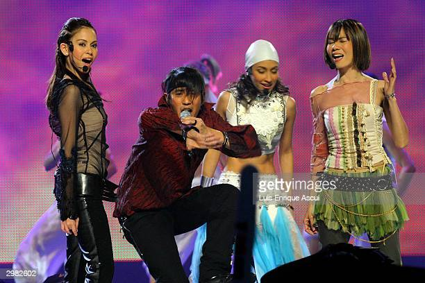 "Bird Thongchai McIntyre performs on stage at the ""MTV Asia Awards 2004"" at the Singapore Indoor Stadium on February 14, 2004 in Singapore. The third..."