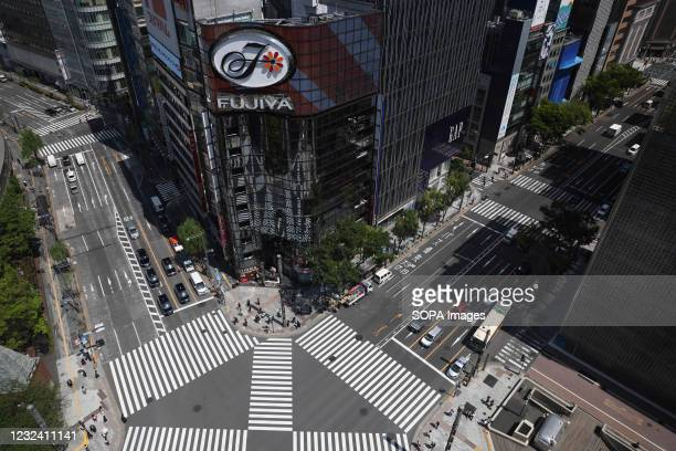 Bird view of a crossroad on Harumi-Dori avenue inside the popular shopping district Ginza. Tokyo's government considers calling a third state of...