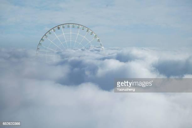 Bird view of Ferris wheel in cloud sea