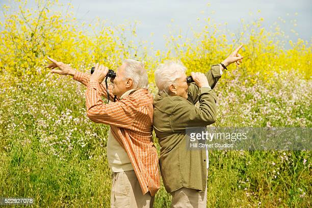 Bird Watchers Pointing in Two Directions