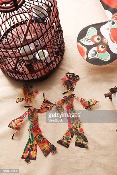 Birdcage and shadow puppet