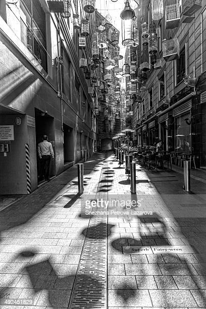 CONTENT] Birdcages and shadows at Angel Place Sydney