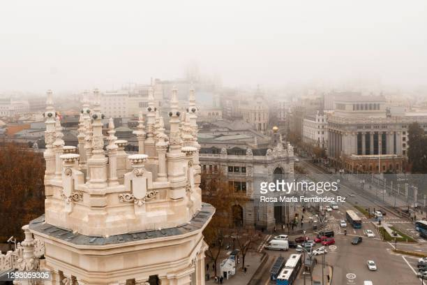 bird'eye of madrid city covered in fog. view of magestic building in the famous alcala street boulevard in the center of madrid, spain - madrid stock pictures, royalty-free photos & images