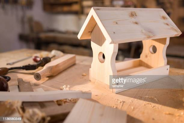 birdhouse on table - birdhouse stock pictures, royalty-free photos & images