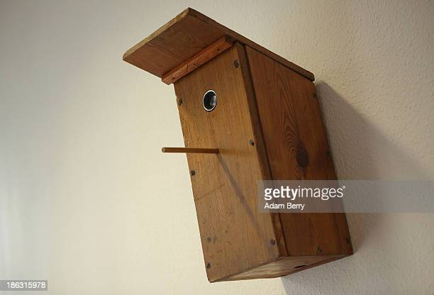 A birdhouse with a hidden camera inside hangs on display at the Stasi or East German Secret Police Museum on October 30 2013 in Berlin Germany German...