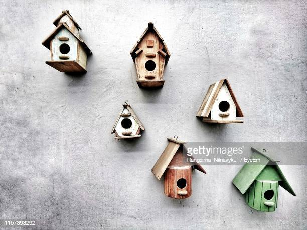 birdhouses on concrete wall - birdhouse stock pictures, royalty-free photos & images