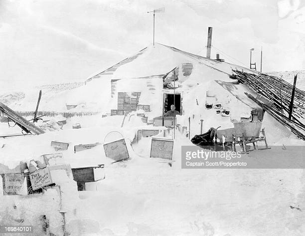 Birdie Bowers at the door of the Winter Quarters expedition hut at Cape Evans photographed during the last tragic voyage to Antarctica by Captain...