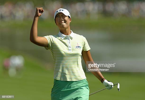 Birdie Kim of Korea celebrates after sinking a birdie shot out of the eighteenth hole bunker to win the 60th U.S. Women's Open Championship at Cherry...