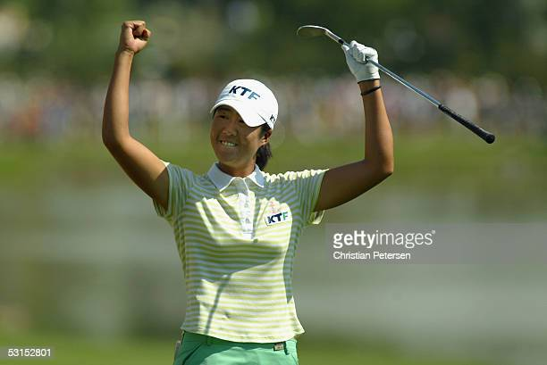 Birdie Kim of Korea celebreates after sinking a birdie shot out of the eighteenth hole bunker during the fourth round of the 60th U.S. Women's Open...