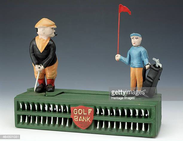 'Birdie Putt' money box Taiwan modelled on 1920s original Reproduction of rare and expensive original metal toy At the push of a button the caddy...