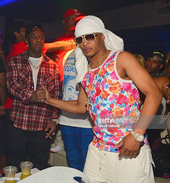 Birdman and TI attend a party hosted by TI and Lil Wayne at Prive on July 12 2013 in Atlanta Georgia