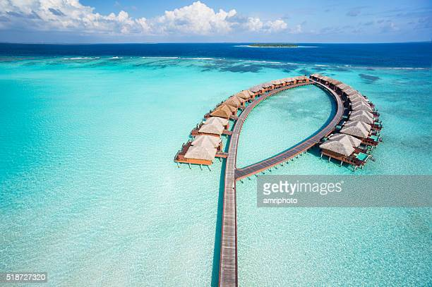 bird's eye view luxury overwater villas - atoll stock pictures, royalty-free photos & images