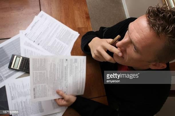 A birds eye view of a man doing his taxes