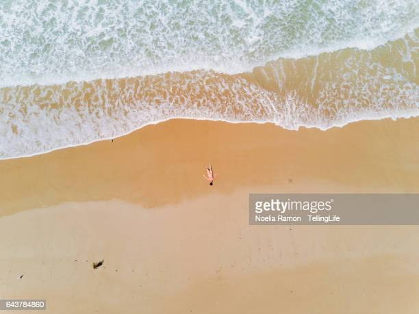 Bird's eye view of a woman at the shore of the beach at Apollo Bay, Great Ocean Road, Victoria, Australia