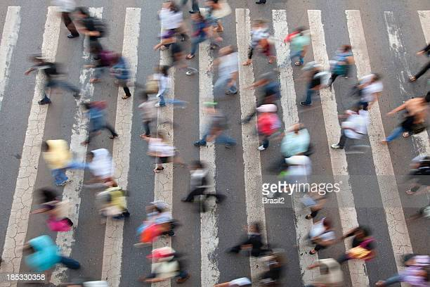 Birds eye view of blurred busy crosswalk