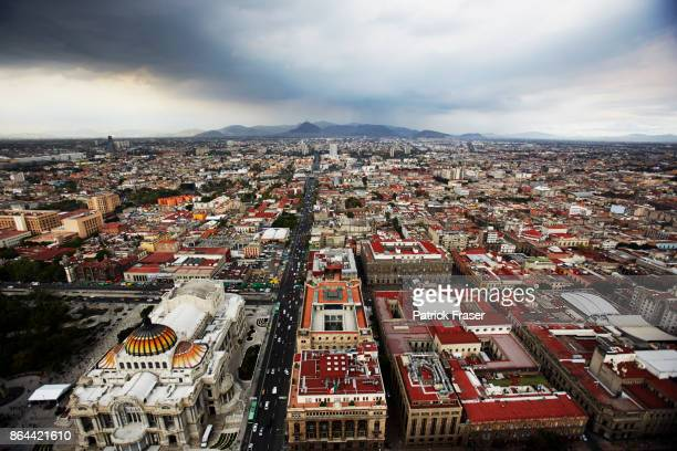 a birds eye view of downtown mexico city featuring the palacio de bellas artes - mexico city aerial stock pictures, royalty-free photos & images