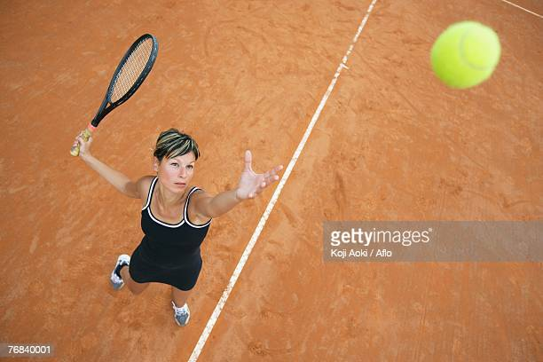 Bird's Eye View of Female Tennis Player Serving