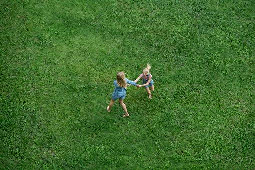 Bird's eye view of mother and daughter having fun in garden - gettyimageskorea