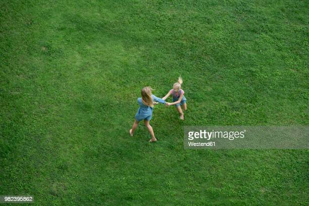 bird's eye view of mother and daughter having fun in garden - elevated view ストックフォトと画像