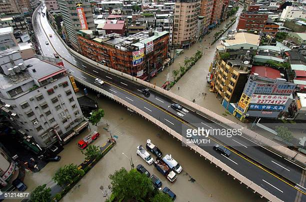 A birds eye view of the flooded streets in Sanchung Taipei county 25 August 2004 China evacuated hundreds of thousands of people as Typhoon Aere...