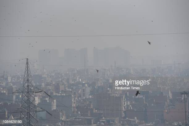 A bird's eye view of the residential houses covered with thick layer of smog as seen from National Highway 24 after pollution level increased on...