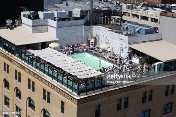 bird's eye view of  the rooftop pool of the soho house new york, on 9th avenue in the meatpacking district, manhattan, new york city - soho house club stock pictures, royalty-free photos & images