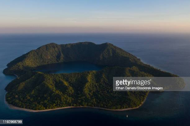 a bird's eye view of the volcanic island of satonda, indonesia. - rinca island stock pictures, royalty-free photos & images