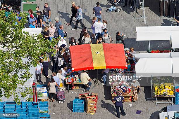 CONTENT] Bird's eye view over a clothing stall at the weekly outdoor market in the centre of Rotterdam Netherlands on a sunny day