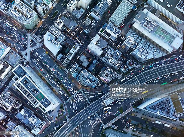 bird's eye view - overhead view of traffic on city street tokyo japan stock photos and pictures