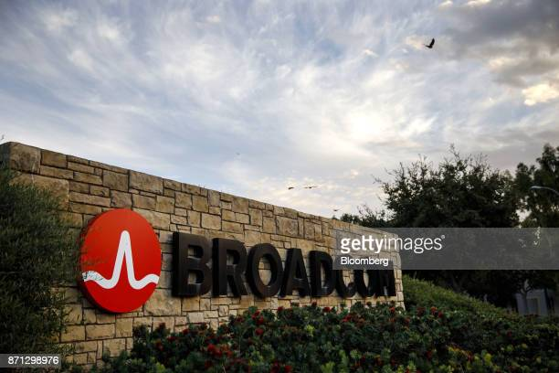 Birds fly above signage displayed outside of Broadcom Ltd headquarters in Irvine California US on Monday Nov 6 2017 Broadcom Ltdand its advisers are...