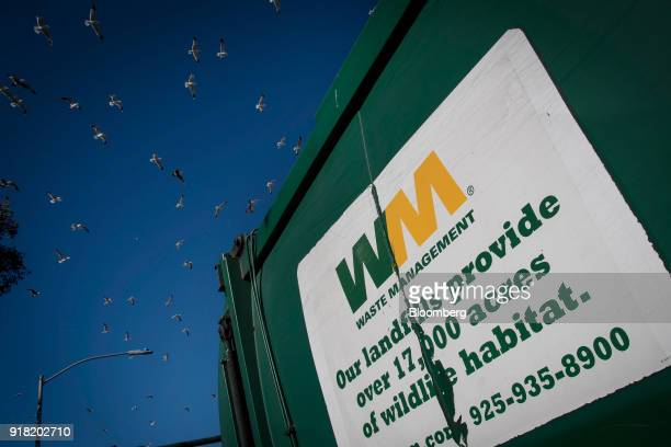 Birds fly above the Waste Management Inc Davis Street Recycling Transfer Station in San Leandro California US on Monday Feb 12 2018 Waste Management...