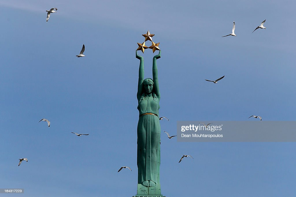 Birds fly around The Freedom Monument honouring soldiers killed during the Latvian War of Independence from1918 to 1920 is pictured on March 21, 2013 in Riga, Latvia.