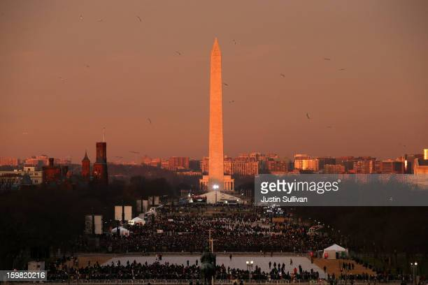 Birds fly over the mall in the early morning in front of the Washington Monument before the presidential inauguration on the West Front of the US...