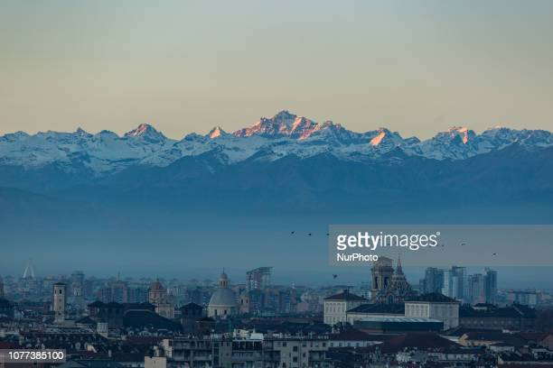 Birds flying in the smog on January 4 2019 View from the Monte dei Cappuccini on the capital of the Northern Italien region Piedmont Turin on January...
