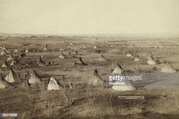 Bird'seye view of a Lakota camp probably on or near Pine Ridge Reservation