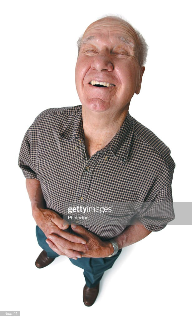 Birdseye view of a man holding his stomach as he laughs. : Foto de stock