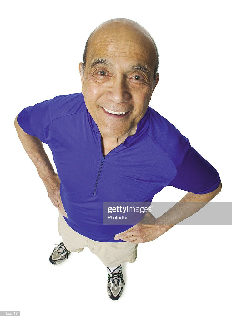 Birdseye view of an elderly balding man smiling at the camera. : Foto de stock