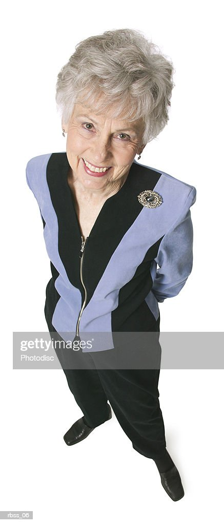 Birdseye view of an elderly woman smiling up at the camera. : Foto de stock